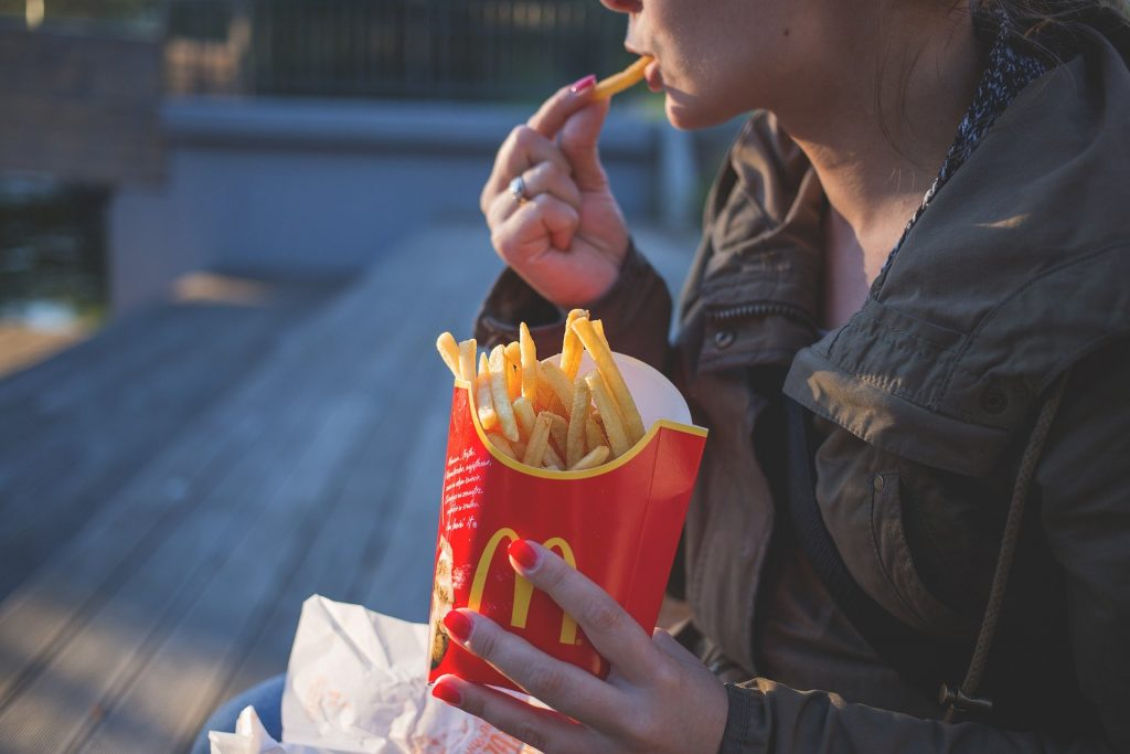 Woman eating McDonalds Fries